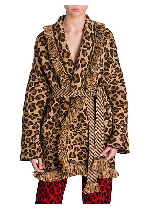 Image of From the Saks IT LIST. PUTTING ON THE KNITS. That favorite-sweater feeling goes from head to toe. ANIMAL INSTINCTS. See spots everywhere. Wild prints like leopard pair back to everything. This exotic cardigan features leopard print framed with boho fringe
