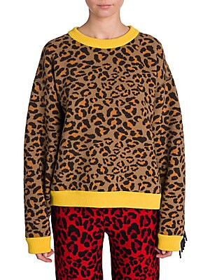 Image of From the Saks IT LIST PUTTING ON THE KNITS That favorite-sweater feeling goes from head to toe. ANIMAL INSTINCTS See spots everywhere. Wild prints like leopard pair back to everything. This classic pullover sweater gets a wild do-over with this leopard in