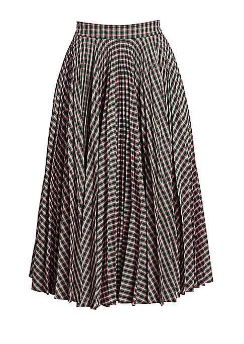 Image of Continuing with his vision of Americana for Calvin Klein, designer Raf Simons takes on the concept of the prairie skirt. His pastoral version boasts a colorful check pattern, with its full circle silhouette further accentuated by allover pleating. Banded