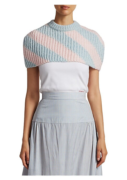 Image of A cropped needle-punch cape featuring wide pastel stripes. The perfect statement piece to go over a fitted tee and skirt outfit. Ribbed highneck. Sleeveless. Pull-on style. Cashmere/wool/nylon. Dry clean. Made in Italy. SIZE & FIT. Draped silhouette. Abou