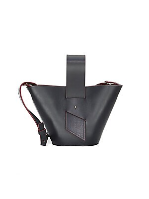 """Image of 60s-inspired colorblock bag with graphic ring handles Adjustable crossbody strap Top handle Magnetic closure 6.5""""W x 6.25""""H x 3""""D Leather Made in Italy. Handbags - Collection Handbags. Carolina Santo Domingo. Color: Black Rust."""