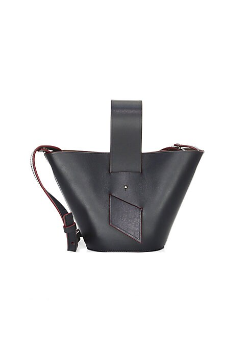 """Image of 60s-inspired colorblock bag with graphic ring handles. Adjustable crossbody strap. Top handle. Magnetic closure.6.5""""W x 6.25""""H x 3""""D.Leather. Made in Italy."""