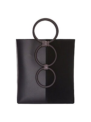 "Image of Circular bar handles lend structural accents to this sleek leather tote. Double top handles Open top Goldtone hardware One interior zip pocket Fully lined Includes dust bag Leather/brass Made in Italy SIZE 9.5""W x 10.5""H x 2""D. Handbags - Collection Handb"