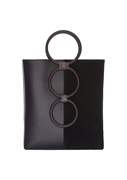 """Image of Circular bar handles lend structural accents to this sleek leather tote. Double top handles. Open top. Goldtone hardware. One interior zip pocket. Fully lined. Includes dust bag. Leather/brass. Made in Italy. SIZE.9.5""""W x 10.5""""H x 2""""D."""