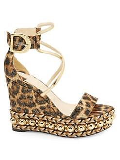 4d60a437fde Product image. QUICK VIEW. Christian Louboutin. Chocazeppa 120 Leopard  Lurex Platform Wedge Sandals