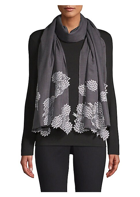 """Image of Warm wool woven scarf finished with silk floral lace trim. Wool/silk. Dry clean. Imported. SIZE.28""""W x 80""""H."""