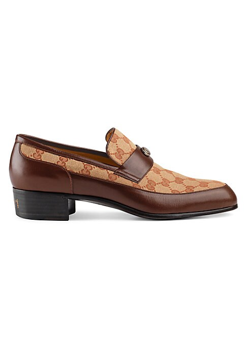 """Image of Original GG loafer with Gucci Team motif. Heel height, 1.5"""".Brick red and beige Original GG canvas. Brown leather trim. Oval enameled detail with metal Double G.Spiked Gucci Team motif on the heel. Made in Italy."""