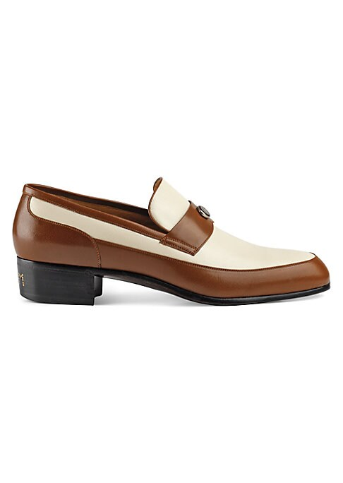 """Image of Leather loafer with Gucci Team motif. Heel height, 1.5"""".Ivory leather. Light brown leather trim. Oval enameled detail with metal Double G.Spiked Gucci Team motif on the heel. Made in Italy."""
