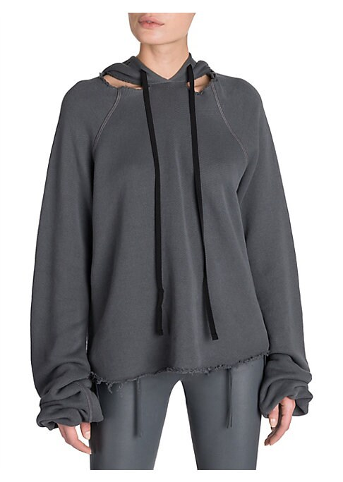 Image of Ben Taverniti's street-born sportswear aesthetic gets the luxe treatment with addition of lush cashmere. The relaxed silhouette features raw cutouts at the neckline, a raw edge hem and elongated sleeves. Attached drawstring hoodie. Raw edge neckline cutou
