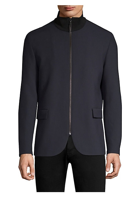 Image of Sporty update on classic smart jacket with zipper details and stand collar. Stand collar. Long sleeves. Zip front. Waist flap pockets. Interior jet button pockets. Fully lined. Polyester/viscose/elastane/cotton. Dry clean. Imported. SIZE & FIT. Regular fi