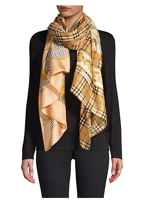 """Image of Brand's iconic tartan merges with artful floral designs to form this stunning silk scarf. Mulberry silk. Dry clean. Made in Italy. SIZE.37.4""""W x 76""""L."""
