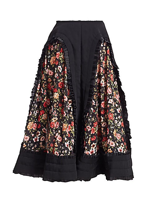 Image of Comme des Garcons redefines the circle skirt with a folk driven lens. The flowing silouhette is made even more feminine with vintage floral panels framed in delicate ruffles for a easy-going yet enchanting effect. Back zip closure. Contrast panels. Ruffle