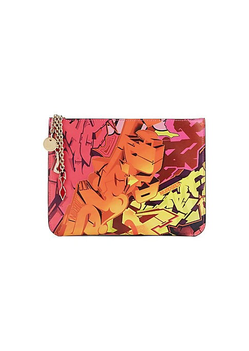 "Image of Bold graffiti print adorns this simple leather clutch with goldtone charms. Top zip closure. Goldtone hardware. Interior slip pocket. Cotton lining. Leather. Made in Italy. SIZE.9""W x 7.75""H x 0.5""D."