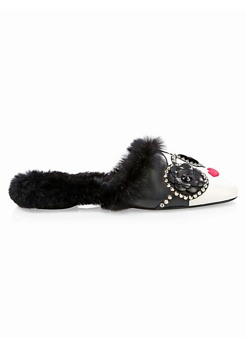 Image of Bold leather slippers are crafted in the likeness of brand's iconic face and finished with a glam faux fur lining. Leather and faux fur upper. Round toe. Slip-on style. Faux fur lining. Leather sole. Fur type: Faux. Imported.