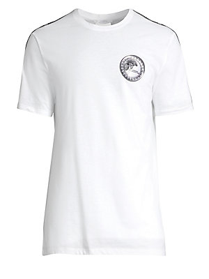 """Image of Opulent medallion logo graphic elevates basic tee. Crewneck Short sleeves Pullover style Cotton Machine wash Imported SIZE & FIT About 27"""" from shoulder to hem. Men Modrn Dsgn - Versace. Versace Collection. Color: White. Size: XL."""