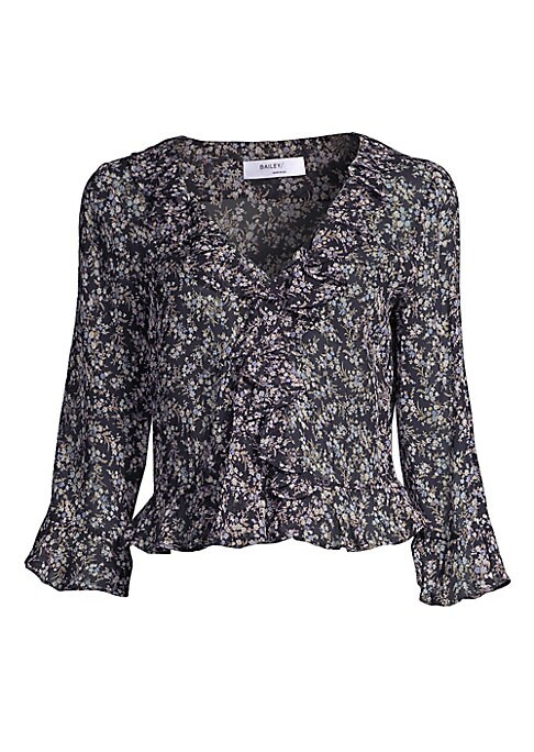 """Image of Charming peplum top with front ruffle trim.V-neck. Three-quarter sleeves. Flared cuffs. Ruffle waist. About 22.5"""" from shoulder to hem. Viscose. Dry clean. Made in USA. Model shown is 5'10"""" (177cm) wearing US size Small."""