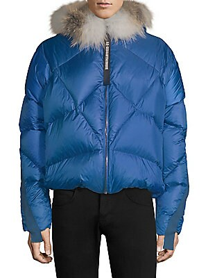 Image of Cozy puffer jacket with removable fox fur trim and military-inspired ribbon. Attached hood Long sleeves Front zip closure Lined Polyester Fill: Goose feather Fur type: Natural fox Fur origin: Finland Dry clean by fur specialist Made in Italy SIZE & FIT Bo