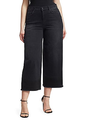 "Image of Retro high-rise jeans boasting frayed wide cuffs. Five-pocket style Zip fly Back logo patch Cotton/elastane Hand wash Imported SIZE & FIT Rise, about 12"" Inseam, about 24"". Salon Z - Rinaldi Salon Z. Ashley Graham x Marina Rinaldi. Color: Black. Size: 14W"