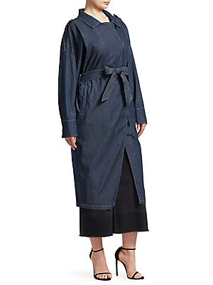 Image of This utilitarian denim dress features a highly functional self-tie waist and zippers that lend an industrial complex to this piece. Notch lapels Long sleeves Snap-buttoned barreled cuffs Asymmetric zip front Self-tie waist Waist welt pockets Cotton/elasta