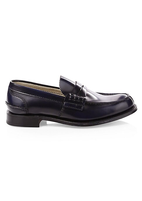 Image of From Church's English Shoes Collection. Timeless dress shoes in a high shine finish with classic penny loafer styling. Leather upper. Apron toe. Slip-on style. Leather sole. Made in UK.