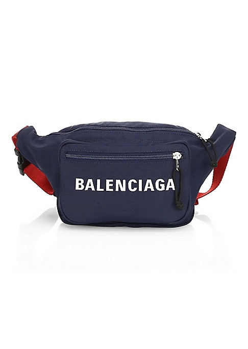 "Image of Call it a belt bag or a fanny pack, this essential streetwear item boasts a contrast strap and is fronted by a crisp logo. Adjustable waist strap. Zip top closure. One exterior zip pocket. Nylon/polyester. Made in Italy. SIZE.9""W x 8""H x 3""D."