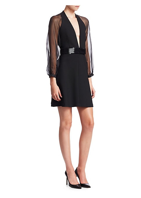 Image of This little black dress exemplifies Emporio Armani's sexy sophisticated aesthetic with it's plunging V-neck, open back and long-sheer sleeves. The short skirt and embellished belt are the perfect mix for cocktail hour. Plunging V-neck. Long sleeves. Open