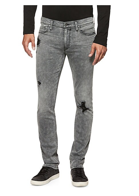 "Image of Stretch jeans in a modern skinny cut with a faded and distressed finish. Belt loops. Zip fly with button closure. Five-pocket style. Rise, about 10"".Inseam, about 33"".Leg opening, about 14"".Rayon/cotton/polyester/spandex. Machine wash. Imported."