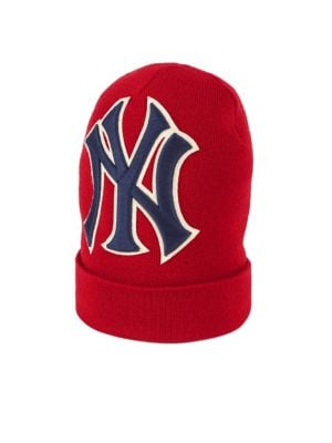 Gucci creative director Alessandro Michele loves to wear his NY Yankees hat  and this red wool beanie style is part of a collaboration with Major League  ... c2ceb4f4c45