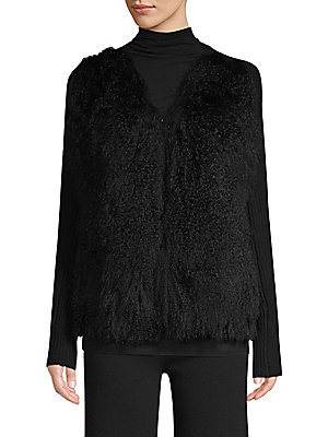Image of From the Saks IT LIST PUTTING ON THE KNITS That favorite-sweater feeling goes from head to toe. Thanks to a gorgeous addition of Tibetan lamb fur, this black cardigan is elevated beyond its position as a wardrobe staple. The body of the sweater is crafted
