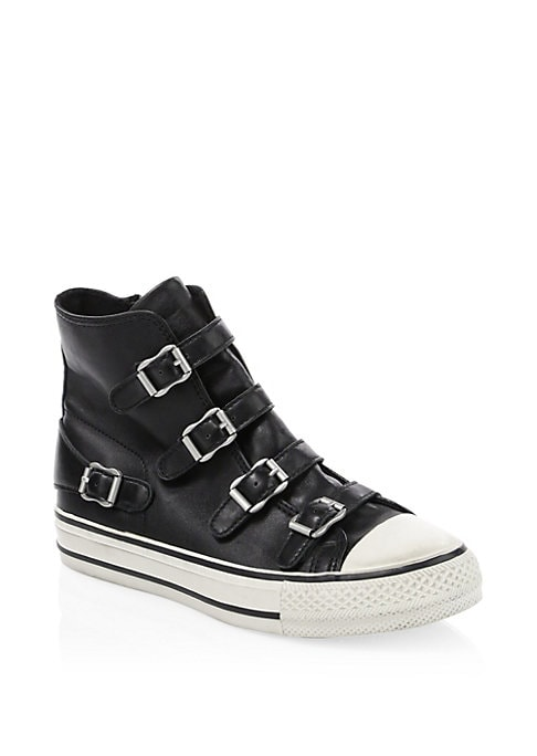 Image of Eclectic buckles offer utilitarian aspect to sneakers. Leather upper. Round. Adjustable tab buckle vamp. Leather lining. Rubber sole. Imported.