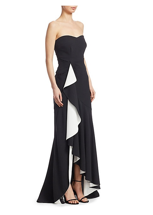 """Image of A figure-flattering strapless with a flounced high-low hem. Sweetheart neck. Strapless. Front colorblock ruffle panel. High-low hem. About 60"""" from shoulder to hem. Polyester/viscose/elastane. Dry clean. Imported. Model shown is 5'10"""" (177cm) wearing US s"""