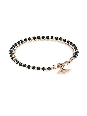 "Image of Black spinel beaded bracelet with 18K goldplated chain and a white sapphire and black spinel set Evil Eye charm White sapphire Black spinel 18K rose goldplating Sterling silver Lobster clasp Imported SIZE Diameter, about 2.3"" Length, about 7.2"" Charm, 0.2"