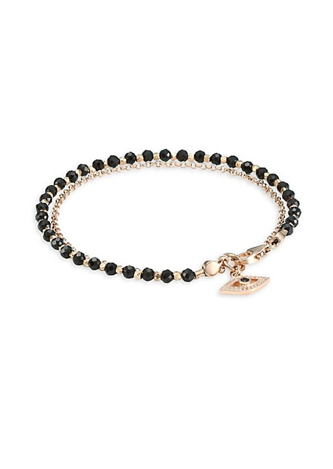 "Image of Black spinel beaded bracelet with 18K goldplated chain and a white sapphire and black spinel set Evil Eye charm. White sapphire. Black spinel.18K yellow goldplating. Sterling silver. Lobster clasp. Imported. SIZE. Diameter, about 2.3"".Length, about 7.2""."