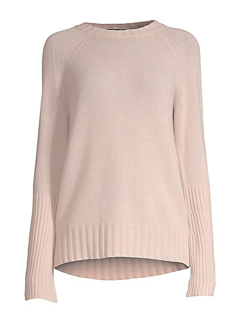 Image of Cozy, cashmere pullover finished in elongated cuffs and wide-ribbed detail. Crewneck. Long sleeves. Ribbed neck, cuffs and hem. Pullover style. Cashmere. Dry clean. Imported. SIZE & FIT. Longline silhouette. About 26' from shoulder to hem. Model shown is