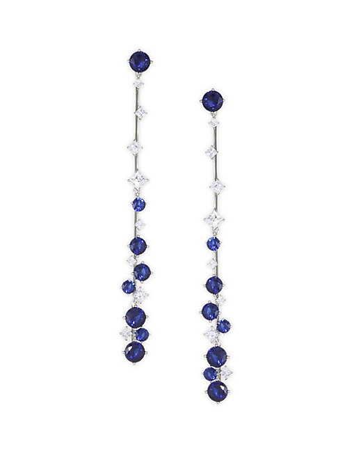 "Image of Celestial earrings flaunting dazzling sapphire-hued crystals. Rhodium-plated silver. Cubic zirconia. Wipe clean. Post back. Imported. SIZE. Drop, about 3.5""."