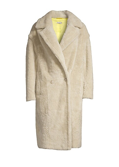 Image of Plush shearling coat is crafted in a minimalist design. Embodying a boxy silhouette, this is a contemporary piece that exudes casual cool. Notch lapels. Long sleeves. Double-breasted button-front. Waist slip pockets. Fully lined. Fuzzy finish. Shearling.