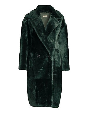 Image of Dazzling fur coat flaunts a bold notch lapel and long drop shoulder sleeves. Crafted in a double-breasted design, this is an elegant and cozy piece. Notch lapels Long sleeve Double-breasted button front Waist slip pockets Fuzzy finish Shearling Fur type: