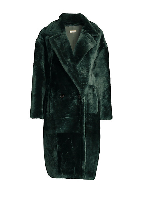 Image of Dazzling fur coat flaunts a bold notch lapel and long drop shoulder sleeves. Crafted in a double-breasted design, this is an elegant and cozy piece. Notch lapels. Long sleeve. Double-breasted button front. Waist slip pockets. Fuzzy finish. Shearling. Fur