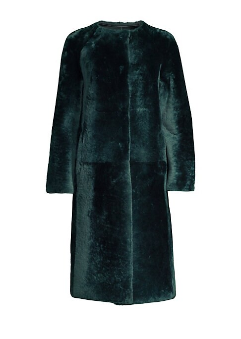 Image of This bold shearling coat exudes glamour and allurement. Plush to the touch and crafted in a boxy silhouette, this is a piece that redefines refinement. Roundneck. Long sleeves. Concealed button front. Side seam waist pockets. Fuzzy finish. Shearling. Fur