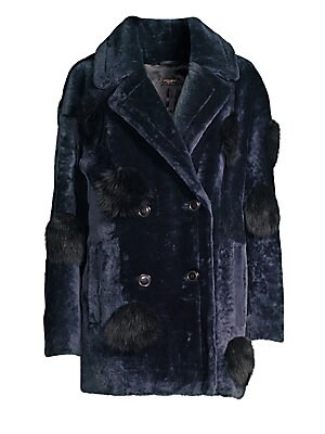 Image of ONLY AT SAKS. This bold shearling piece exudes glamour and sophistication. Simply pull it over any ensemble and it will be one striking outfit. Notch lapels Long sleeves Double-breasted button front Waist welt pockets Pom poms Fully lined Fur finish Shear