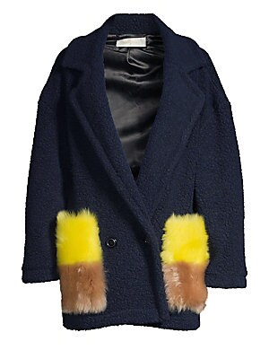 Image of ONLY AT SAKS. This wool-blend coat flaunts bold two-tone fur pockets that embody individuality. Renowned for its craftsmanship, this coat merges simple Nordic craftsmanship with Parisian timelessness. Notch lapels Long sleeves Double-breasted button front