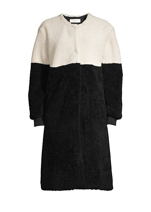 Image of This plush shearling coat flaunts a two-tone design that exudes geometric intricacy. Designed with rib-knit cuffs, this is a contemporary piece made for warmth and style. Roundneck. Long sleeves. Rib-knit cuffs. Concealed snap-button front. Fully lined. F