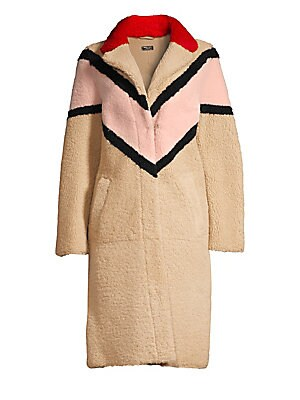 Image of This eclectic shearling coat flaunts chevron colorblock embellishments. Bold and colorful, this piece is flamboyant in every day. Notch lapels Long sleeves Keyhole pom pom button front Waist slip pockets Back vent Shearling Fur type: Dyed real shearling F