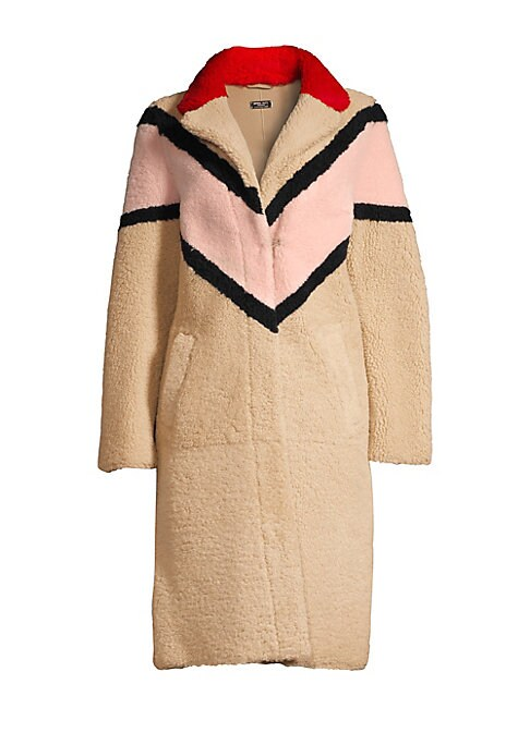 Image of This eclectic shearling coat flaunts chevron colorblock embellishments. Bold and colorful, this piece is flamboyant in every day. Notch lapels. Long sleeves. Keyhole pom pom button front. Waist slip pockets. Back vent. Shearling. Fur type: Dyed real shear