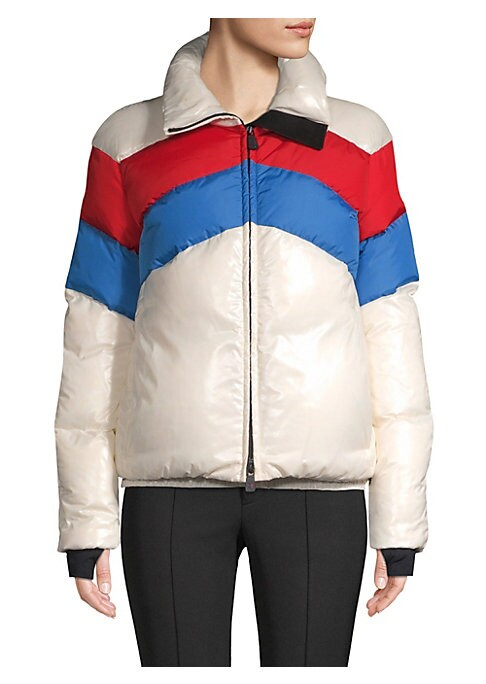 Image of This bold puffer jacket flaunts a colorblock chevron design. Designed to be athletic and vigorous, this piece is built for durability and flair. Stand collar. Long sleeves. Thumbhole cuffs. Zip front. Side seam zip waist pockets. Elasticized hem. Quilted