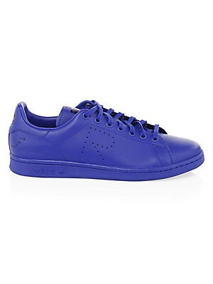 Image of Essential leather sneakers with signature perforated detail Leather upper Round toe Lace-up vamp Rubber sole Imported. Men's Shoes - Designer Shoes. adidas by Raf Simons. Color: Mystery Ink. Size: 10.