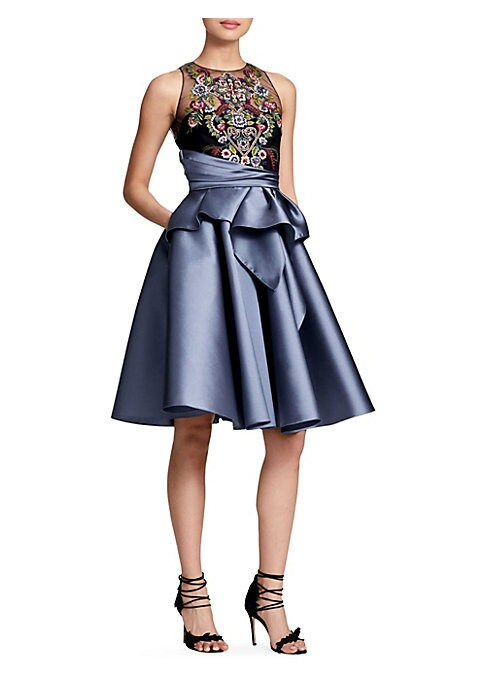 Image of This alluring dress features a floral-embroidered sheer bodice and a satin skirt. Roundneck. Sleeveless. Concealed back zip with keyhole button closure. Asymmetric ruched waist. Tiered ruffled skirt. Polyester lining. Nylon. Dry clean. Imported of Italian