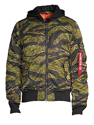 "Image of Hooded nylon jacket in a wild camouflage print. Attached hood Long sleeves Front flap pockets Zip-front Nylon Dry clean Imported SIZE & FIT Standard fit About 28"" from shoulder to hem. Men Adv Contemp - Contemporary Outerwear > Saks Fifth Avenue. Alpha In"
