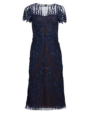 """Image of Enchanting floral embroidery lends decadence to this svelte tulle dress. Roundneck Sheer yoke Short scalloped sleeves Concealed back zip Polyester lining Nylon Dry clean Imported SIZE & FIT About 48"""" from shoulder to hem Model shown is 5'10"""" (177cm) weari"""