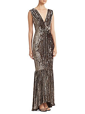 """Image of Glamorous mermaid gown lends a striking pleated texture and waist applique Surplice V-neck Sleeveless Concealed back zip Banded waist V-back Mermaid hem Shell/lining: Polyester Dry clean Imported SIZE & FIT Mermaid silhouette About 62"""" from shoulder to he"""